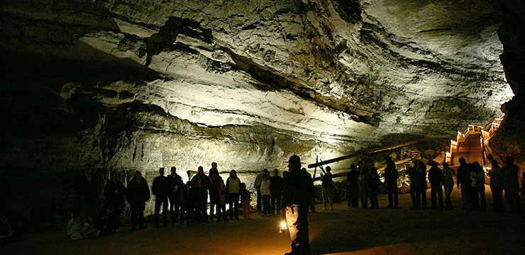 A large group of people attending a tour of Mammoth Cave