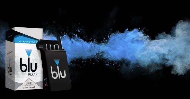 A blu PLUS pack alongside its package with blue vapor in the background