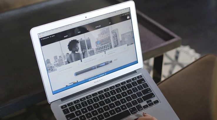 A woman accessing the blu website using a laptop