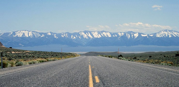An image of Route 50 with a mountain range in the distance
