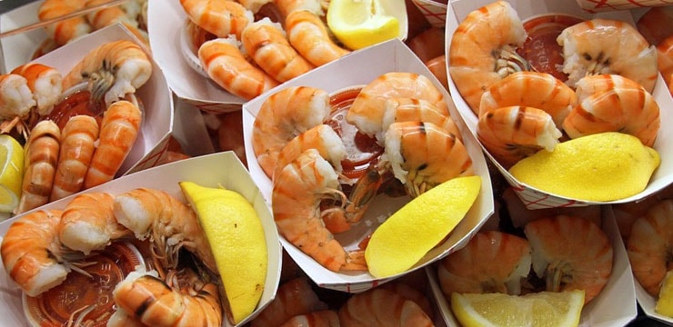 Trays of shrimp with sauce and lemon wedges from the Boston Seafood Festival