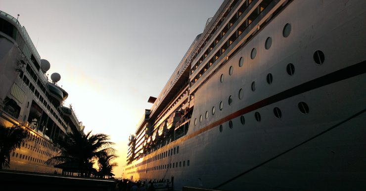 A photo of a cruise liner taken from the dock at sunset