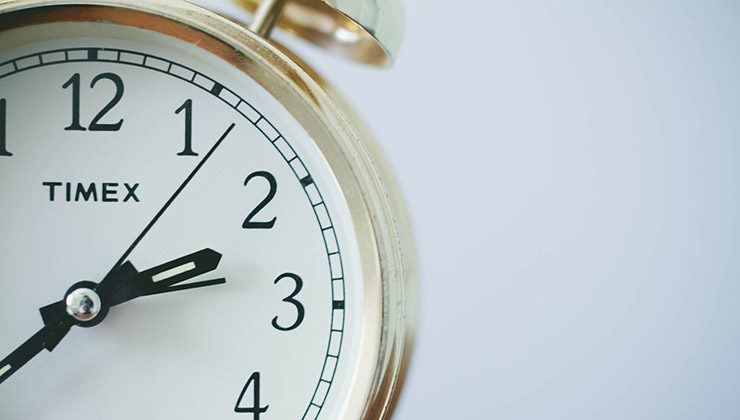 An alarm clock against a white background