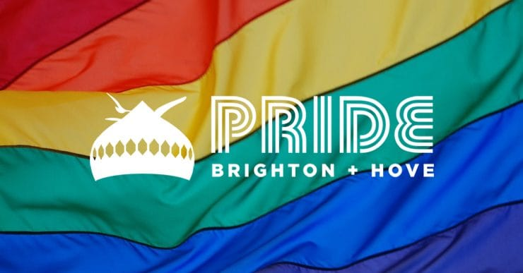 The Brighton Pride logo over a multicoloured flag
